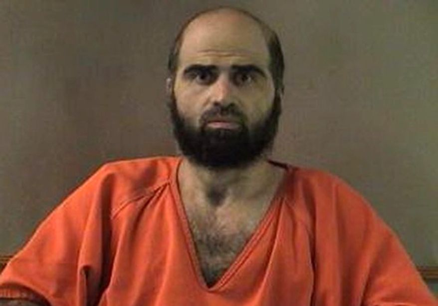An Army appeals court will hear arguments on Thursday, Oct. 11, 2012, in the case of Maj. Nidal Hasan, the Army psychiatrist charged in the deadly 2009 Fort Hood shooting rampage, over whether Maj. Hasan will be required to have his beard shaved before his court-martial. The issue has indefinitely postponed his murder trial. Maj. Hasan argues that the order violates his religious rights. (AP Photo/Bell County Sheriff's Department via The Temple Daily Telegram)