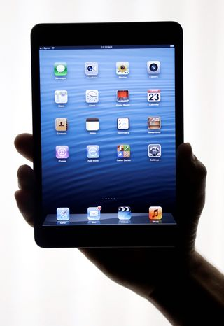 The iPad Mini is shown in San Jose, Calif., on Tuesday, Oct. 23, 2012. Apple Inc. is refusing to compete on price with its rivals in the tablet market, as the company is pricing the new, smaller iPad well above the competition. The iPad Mini, with a screen that's about two-thirds the size of the full-size model, will cost $329 and up. (AP Photo/Marcio Jose Sanchez)