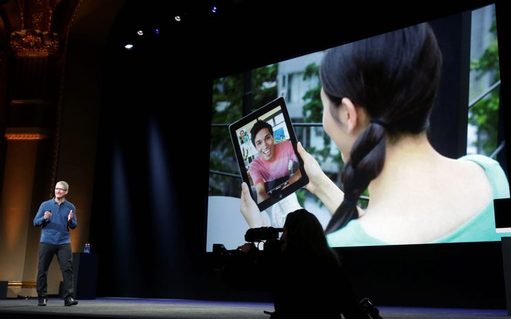 Apple CEO Tim Cook speaks about the iPad's impact on the marketplace during the introduction of the iPad Mini in San Jose, Calif., on Tuesday, Oct. 23, 2012. The device has a screen that's about two-thirds the size of the full-size model and will cost $329 and up. (AP Photo/Marcio Jose Sanchez)