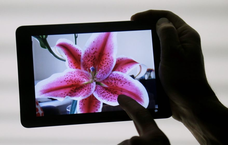 Apple's iPad Mini is shown in San Jose, Calif., on Tuesday, Oct.  23, 2012. The new device has a screen that's about two-thirds the size of the full-size model and will cost $329 and up. (AP Photo/Marcio Jose Sanchez)