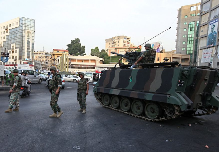 Lebanese Army soldiers patrol Oct. 22, 2012, in the northern port city of Tripoli, Lebanon, during clashes that erupted between supporters and opponents of the Syrian regime. Lebanese troops launched a major security operation to open all roads and force gunmen off the streets, trying to contain an outburst of violence set off by the assassination of a top intelligence official who was a powerful opponent of Syria. (Associated Press)