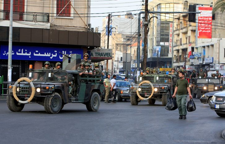 Lebanese Army soldiers patrol Oct. 22, 2012, in the northern port city of Tripoli, Lebanon, during clashes that erupted between supporters and opponents of the Syrian regime. Lebanese troops launched a major security operation to open all roads and force g