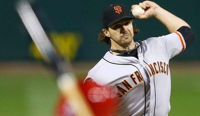 San Francisco Giants starting pitcher Barry Zito throws during the first inning of Game 5 of baseball's National League championship series against the St. Louis Cardinals, Friday, Oct. 19, 2012, in St. Louis. (AP Photo/Elsa, Pool)