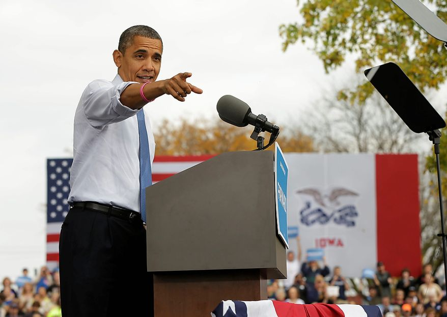 President Obama points to supporters in the audience as he speaks Oct. 24, 2012, during a campaign event at the Mississippi Valley Fairgrounds in Davenport, Iowa. The president began a two-day campaign blitz through eight states with stops in key battleground states Iowa, Colorado, Nevada, Ohio and Virginia. (Associated Press)
