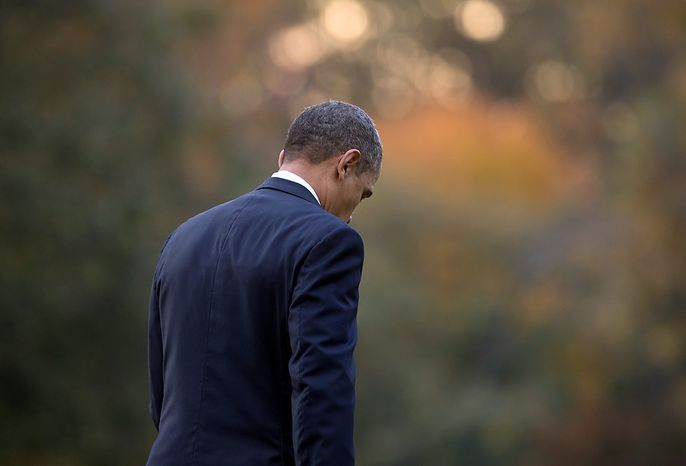 President Obama walks from the White House to Marine One on Oct. 24, 2012, en route to Andrews Air Force Base, Md., then onto campaign events in Iowa, Colorado, California and Nevada. (Associated Press)