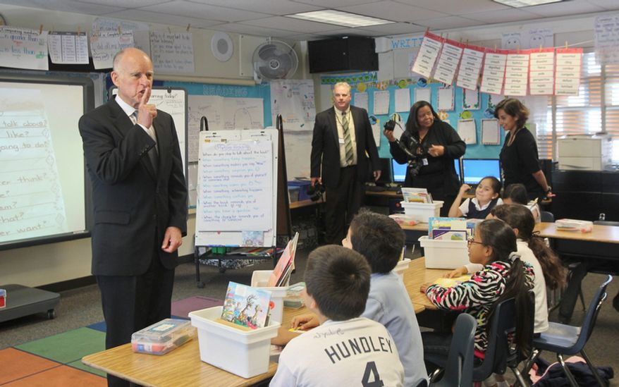 California Gov. Jerry Brown shushes the students of a second-grade class at Perkins Elementary School in San Diego during a Oct. 23, 2012, campaign trip. Brown is visiting Southern California cities to drum up support for Proposition 30. The tax plan would boost the state sales tax by a quarter cent for four years and raise income taxes for seven years on those who make more than $250,000 annually. (Associated Press)