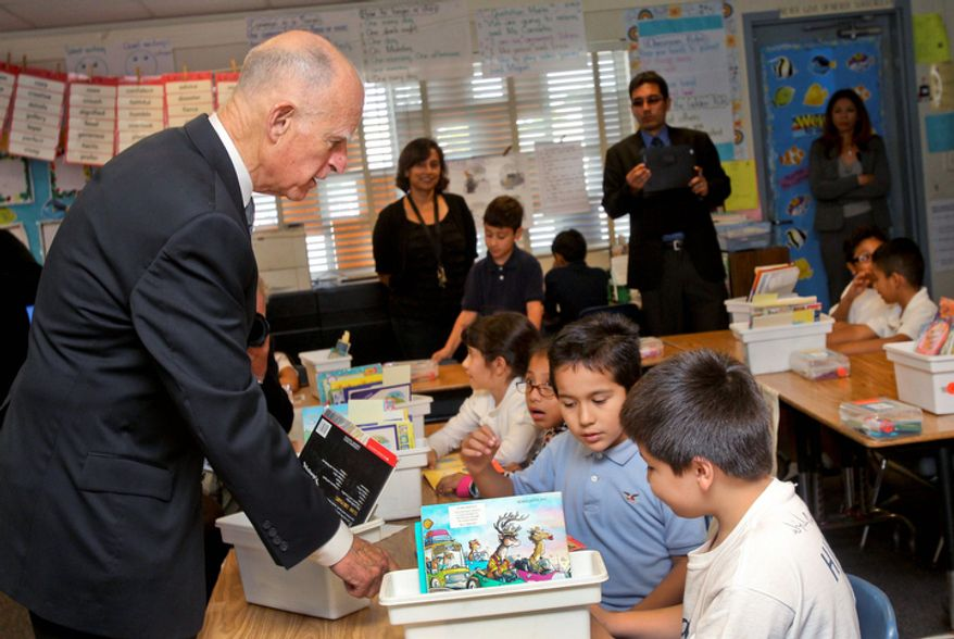 California Gov. Jerry Brown talks Oct. 23, 2012, with students of a second-grade class at Perkins Elementary School in San Diego. Brown is making appearances around the state to push for Proposition 30, which would boost the state sales tax by a quarter cent for four years and raise income taxes for seven years on those who make more than $250,000 annually. (Associated Press)