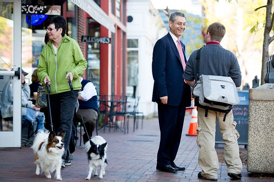 Rob Sobhani (center), an independent candidate for U.S. Senate from Maryland, talks with Brian Phipps (right) of Arnold, Md., along the downtown harbor in Annapolis on Wednesday, Oct. 17, 2012. (Andrew Harnik/The Washington Times)