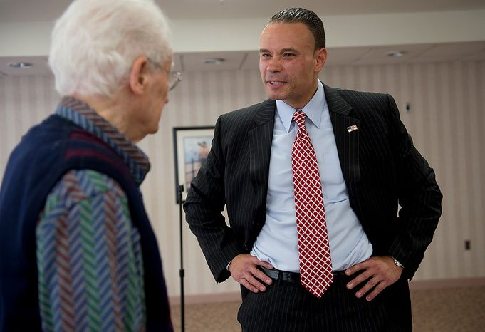 "Dan Bongino (right), the Republican candidate for the U.S. Senate from Maryland, speaks with a resident of the Ring House retirement community in Rockville, Md., following a talk he gave there on Thursday, Oct. 18, 2012. Mr. Borgino said that while he recognizes that Maryland is a tough state because it usually votes Democratic, he believes he can win because he is ""running on ideas, not party politics."" (Barbara L. Salisbury/The Washington Times)"