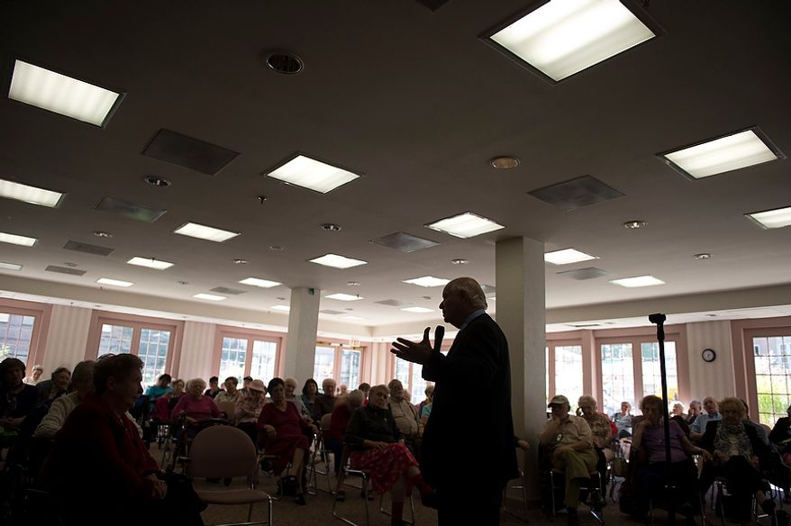 In the weeks leading up to Election Day, Samuel Neff of Rockville, Md., listens as Sen. Benjamin L. Cardin, Maryland Democrat, offers remarks and fields questions from senior citizens at Ring House in Rockville on Monday, Oct. 22, 2012. (Rod Lamkey Jr./The Washington Times)