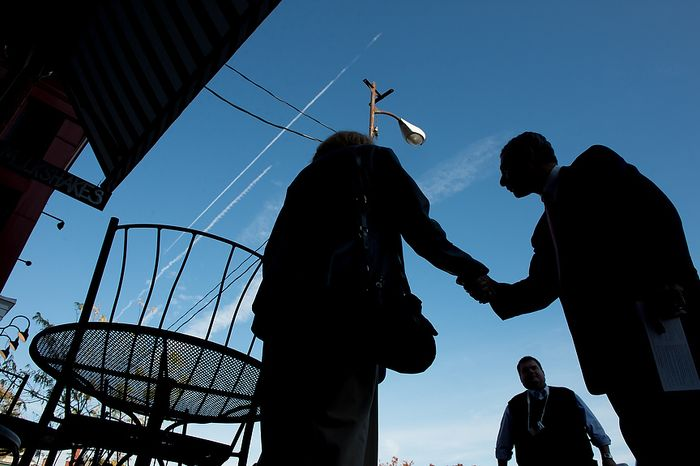 Rob Sobhani (right), an independent candidate for U.S. Senate from Maryland, greets Elinor and Hal Ozkaptan (center) along the downtown harbor in Annapolis on Wednesday, Oct. 17, 2012. (Andrew Harnik/The Washington Times)
