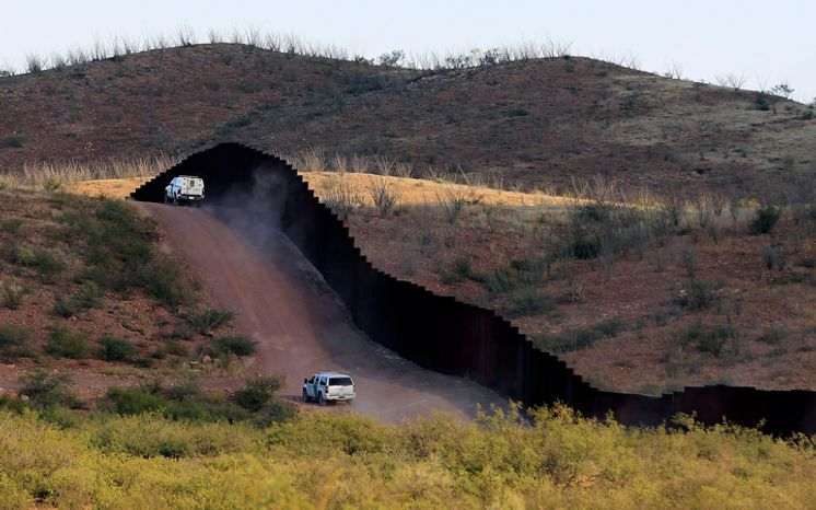 U.S. Border Patrol agents patrol the border fence in Naco, Ariz., on Tuesday, Oct. 2, 2012, near where Agent Nicholas Ivie was shot and killed and one other was shot and injured. (Associated Press)