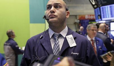 Trader Daniel Chiarmonte works on the floor of the New York Stock Exchange on Wednesday, Oct. 24, 2012. (AP Photo/Richard Drew)