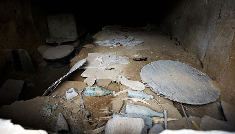 In this photo taken Thursday, Oct. 18, 2012, dusty remnants of an abandoned cave dwelling where Chinese Vice President Xi Jinping used to live during his youth when he was sent to learn peasant virtues at Liangjiahe village in northwestern China's Shaanxi province. Xi, 59 and the country's vice president is expected to take over as head of the ruling party in November, 2012, before becoming president in 2013 of an increasingly assertive China. The Liangjiahe years are among scant details known about Xi's life and personality partly because he himself chronicled them as a key formative experience. (AP Photo/Ng Han Guan)