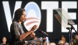 First lady Michelle Obama talks about getting out the vote during a campaign rally in Oct. 19 in Racine, Wis. About 2,500 people gathered to see her speak at Memorial Hall. (Journal Times via Associated Press)