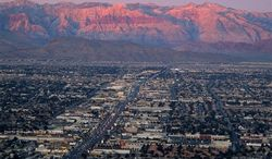 ** FILE ** This Feb. 9, 2005, file photo, shows the suburbs of Las Vegas from atop the Stratosphere tower looking west down Sahara Avenue towards the Spring Mountains. New census data released Thursday, Oct. 25, 2012, offer a detailed look at U.S. migration as mobility begins to revive after sliding to a record low last year. (AP Photo/Joe Cavaretta, File)