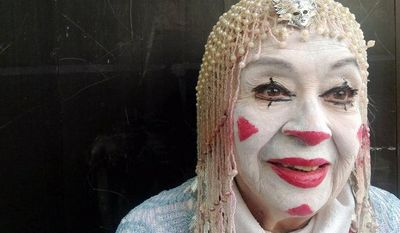 In this Tuesday, Oct. 23, 2012 photo, straight white face clown Tikitiki, 83, poses for a photo during Mexico's 17th annual clown convention, La Feria de la Risa, in Mexico City.  Approximately 500 clowns gathered at two local theaters in the capital city to exchange ideas, compete for laughs and show off their comedy performances. (AP Photo/Anita Baca)