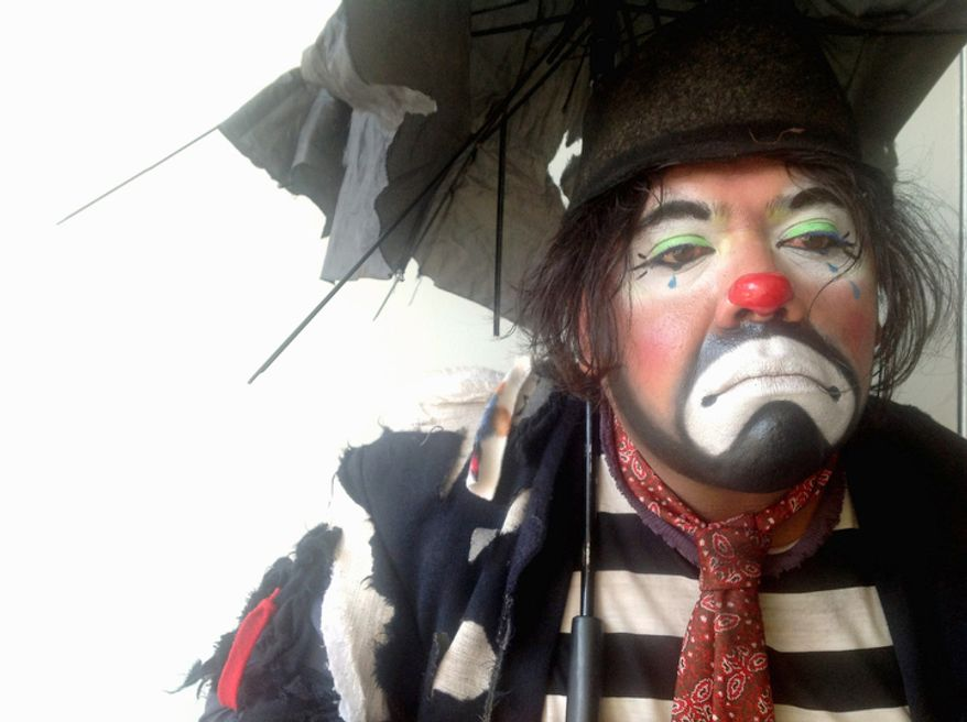 Chicharon, 31, a tramp clown, poses for a photo during Mexico's 17th annual clown convention, La Feria de la Risa, in Mexico City, Wednesday, Oct. 24, 2012.  He has been a clown for 15 years. (AP Photo/Anita Baca)