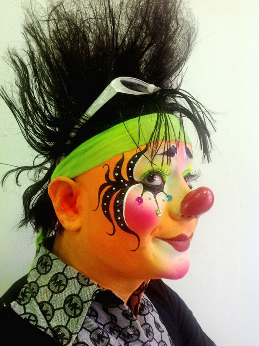 Rayito Show, 35, an Auguste clown, poses for a photo during Mexico's 17th annual clown convention, La Feria de la Risa, in Mexico City. Approximately 500 clowns gathered at two local theaters in the capital city to exchange ideas, compete for laughs and show off their comedy performances. (AP Photo/Anita Baca)