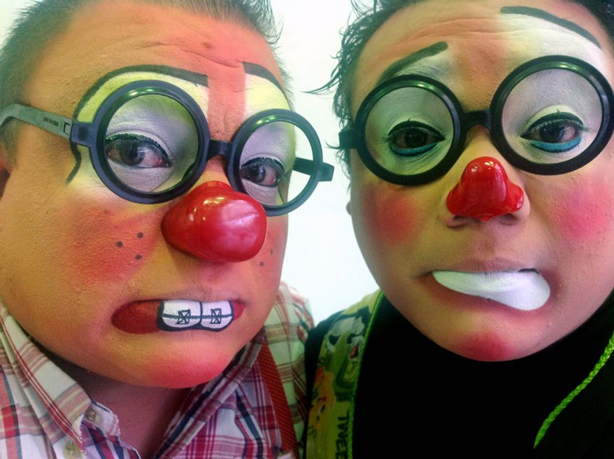 AmPolllita, 35, left, and his brother Yulin, 27, pose for a photo during Mexico's 17th annual clown convention, La Feria de la Risa, in Mexico City. Approximately 500 clowns gathered at two local theaters in the capital city to exchange ideas, compete for laughs and show off their comedy performances. The Auguste duo from Monterrey who form a group called QueChichones, have been performing as clowns for 9 years. (AP Photo/Anita Baca)