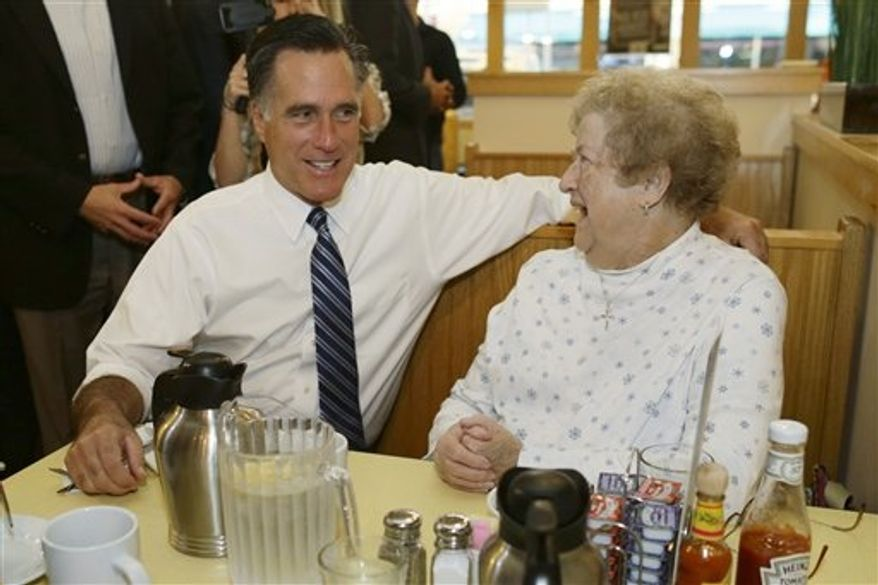 Republican presidential candidate, former Massachusetts Gov. Mitt Romney sits and talks to a customer as he makes an unscheduled stop at First Watch cafe in Cincinnati, Ohio, Thursday, Oct. 25, 2012. (AP Photo/Charles Dharapak)