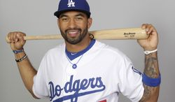 FILE - This 2012 file photo shows Matt Kemp of the Los Angeles Dodgers baseball team.  Kemp is in Arizona to begin rehabbing from the Oct. 5 surgery that repaired a torn labrum and damage to the rotator cuff, injuries resulting from a crash into the center field wall at Coors Field on Aug. 27. Doctors have said he should be ready by spring training. (AP Photo/Jae C. Hong, File)