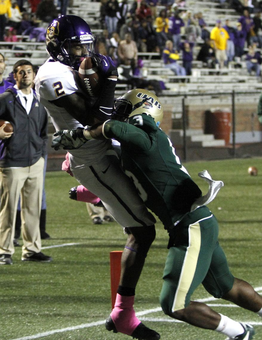 East Carolina receiver Justin Hardy (2) catches a pass for a touchdown over UAB cornerback Darius Powell (13) during the fourth quarter of an NCAA college football game Saturday, Oct. 20, 2012, in Birmingham, Ala. (AP Photo/ Butch Dill)