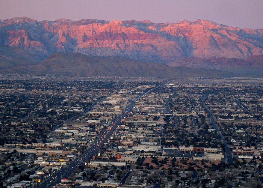 The suburbs of Las Vegas are shown from atop the Stratosphere tower looking west down Sahara Avenue toward the Spring Mountains on Feb. 9, 2005. (AP Photo/Joe Cavaretta)