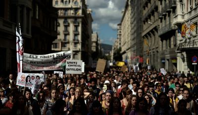 Students protest education cuts at Sant Jaume Square in Barcelona on Wednesday, Oct. 17, 2012. The Spanish government said Wednesday it will decide within the next few weeks whether to ask for outside financial help, noting it might opt for a precautionary line of credit instead of bailout cash. (AP Photo/Manu Fernandez)