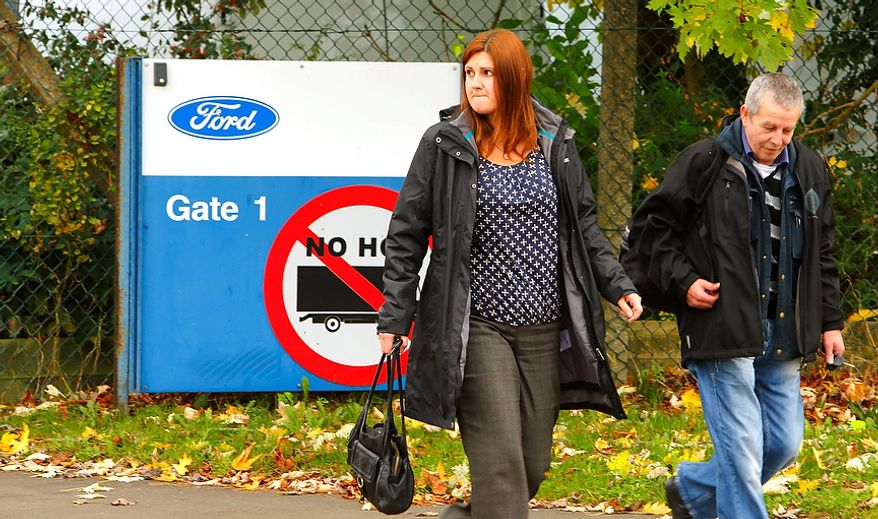 Workers leave the Ford Transit Assembly Plant in Southampton, England, on Thursday, Oct. 25, 2012, as union leaders are called to a meeting with car giant Ford Motor Co. amid fears that the firm's U.K. van factory is to close. Ford, which expects to lose more than $1 billion a year in Europe, has been pursuing plant closures and layoffs. (AP Photo/Chris Ison/PA Wire)