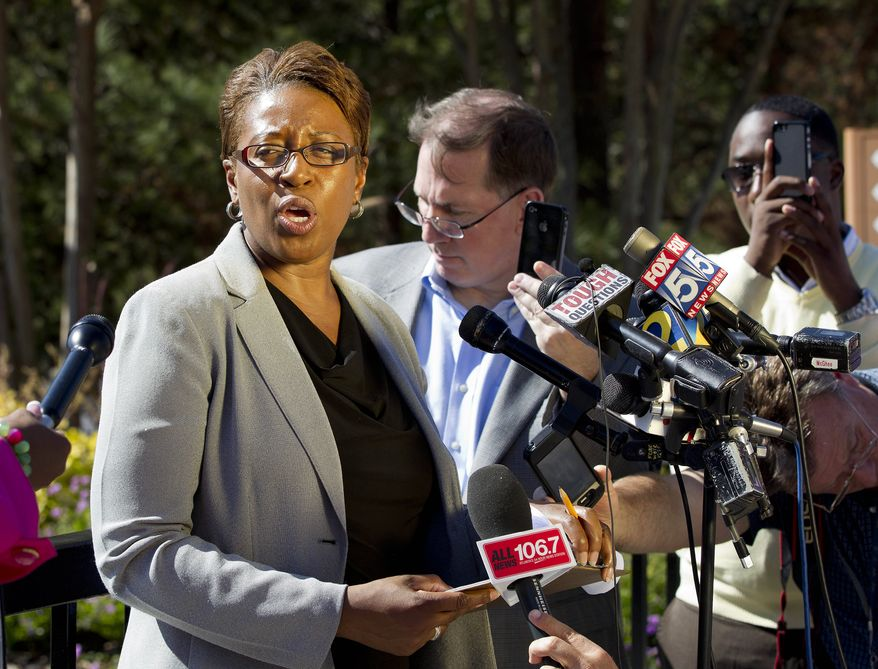 Cpl. Kay Lester, Fulton County police spokeswoman, speaks to reporters outside the World Changers International church in College Park, Ga., after a fatal shooting inside on Wednesday, Oct. 24, 2012. Police say a volunteer leading a prayer service was shot and killed by a former church employee. (AP Photo/John Bazemore)