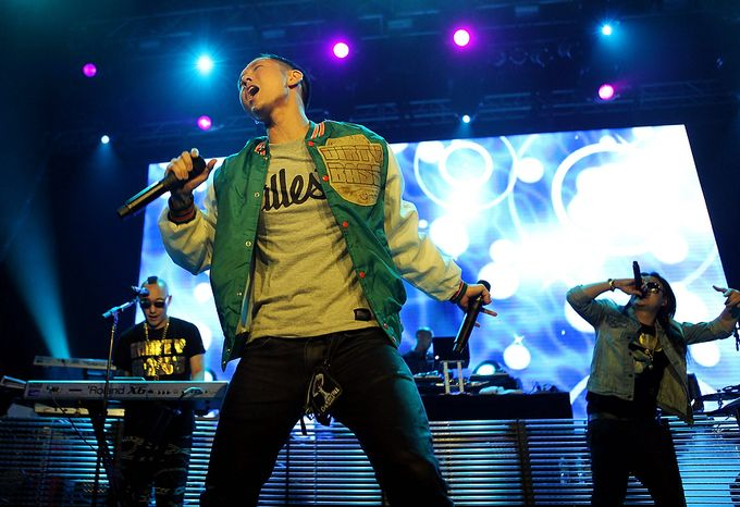In this photo provided by HP, Far East Movement performs to celebrate the launch of HP's new line of Windows 8 touch-technology products Wednesday, Oct. 24, 2012 in New York. On Thursday in New York, Microsoft will unveil a dramati