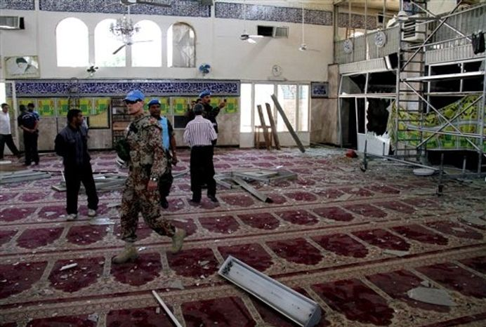 ** FILE ** In this June 14, 2012, file photo, U.N. observers inspect the prayer hall of the Sayyida Zeinab shrine, which was damaged after a car bomb exploded near the shrine, in a suburb of Damascus, Syria. Iraqi Shiites increasingly fear the Muslim sect and its holy sites could be targeted in Syria, and Iranian-linked militants loyal to the