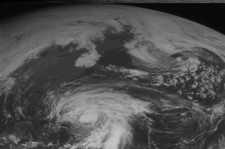 This NOAA satellite image taken October 25, 2012 at 10:45 AM EDT shows Hurricane Sandy over the Bahamas with maximum sustained winds of 105 mph and moving toward the north. Farther north, a cold front moves into the Great Lakes and Ohio Valley with showers and thunderstorms. (Associated Press/Weather Underground)