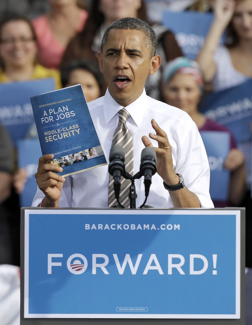 President Obama holds up his jobs plans booklet while speaking Oct. 25, 2012, at a campaign event in Tampa, Fla. (Associated Press)