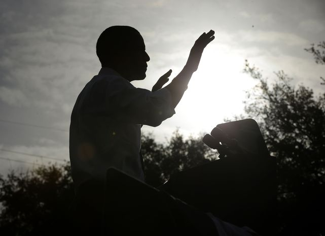 A silhouetted President Obama speaks Oct. 25, 2012, at a campaign event in Tampa, Fla. (Associated Press)