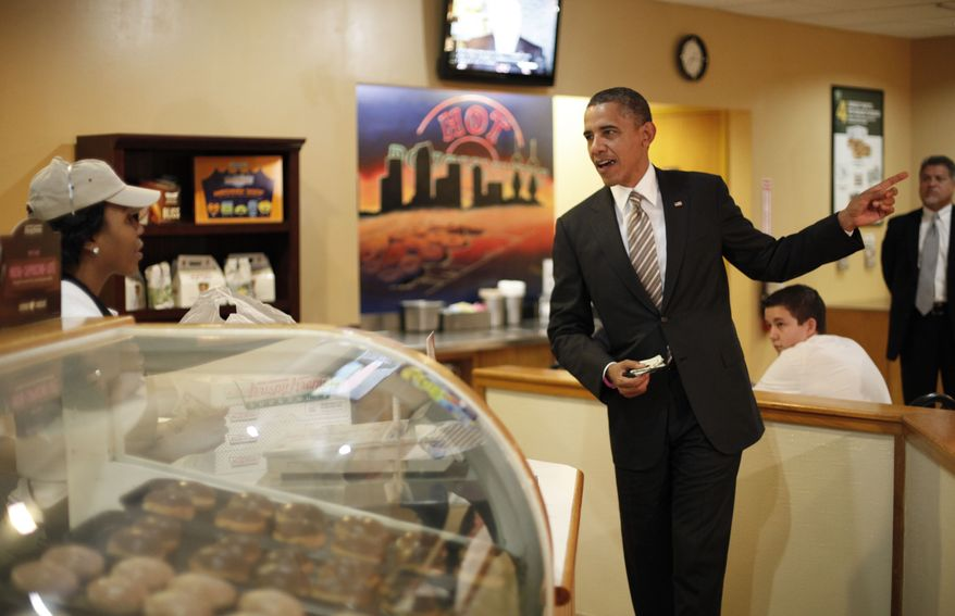 President Obama makes an order Oct. 25, 2012, during an unannounced visit to Krispy Kreme Doughnuts in Tampa, Fla. Obama, who traveled to Florida for a campaign event nearby, surprised local patrons when he drove up in the morning. (Associated Press)