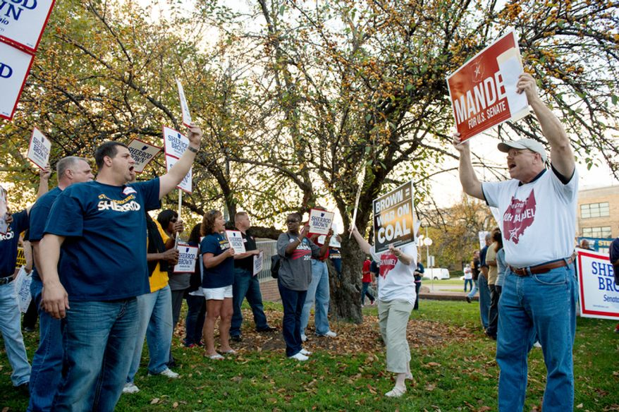 Supporters for U.S. Senate candidates Sen. Sherrod Brown (D-Ohio) and State Treasurer Josh Mandel (R) spare off during a heated rally outside the WCET-TV Studios where the candidates are set to debate each other, Cincinnati, Ohio, Thursday, October 25, 2012. (Andrew Harnik/The Washington Times)