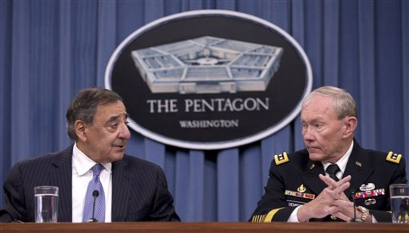 Defense Secretary Leon Panetta, left, and Joint Chiefs Chairman Gen. Martin Dempsey participate in a joint news conference at the Pentagon, Thursday, Oct. 25, 2012. Panetta said the U.S. military did not intervene during the attack on the U.S. Consulate in Libya last month because it was over before the U.S. has sufficient information on which to act. (AP Photo/Carolyn Kaster)