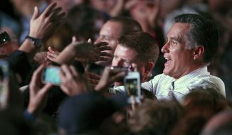 Republican presidential candidate Mitt Romney greets supporters following a campaign rally in Reno, Nev., on Wednesday, Oct. 24, 2012. (AP Photo/Cathleen Allison)