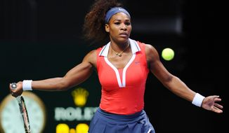 Serena Williams of the U.S. returns a shot to Na Li of China during their tennis match on the second day of the WTA championship in Istanbul, Turkey, Wednesday, Oct. 24, 2012. (AP Photo)