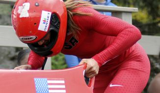 FILe - This Oct. 5, 2012 file photo shows Lolo Jones competing in the U.S. women's bobsled push championships n Lake Placid, N.Y.  Jones says she's still planning to compete in hurdles at the 2016 Rio de Janeiro Olympics. Only now, a trip to the 2014 Sochi Games may come first. Jones was one of 24 athletes selected to the U.S. bobsled team Thursday, Oct. 25, 2012. (AP Photo/Michael Lynch, File)