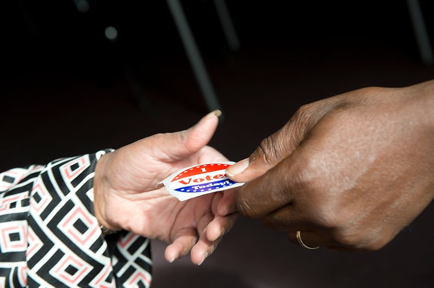 "A voter collects her ""I Voted Today"" sticker after voting early at Judiciary Square in Washington on Wednesday, Oct. 24, 2012. According to site officials, some 2,400 people have voted here since Monday, when the voting opened. The District of Columbia will open seven more early-voting sites on Saturday (one in each ward), which will be open daily except Sundays until Nov. 3 from 8:30 a.m. to 7 p.m. (Barbara L. Salisbury/The Washington Times)"