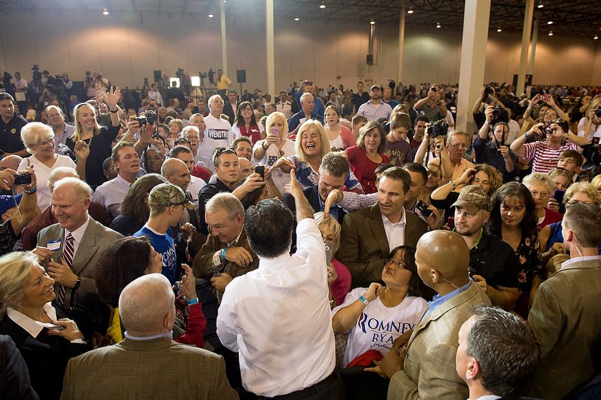 Mitt Romney shakes hands with supporters after a campaign speech at Jet Machine, a small business military manufacturing company, Cincinnati, Ohio, Thursday, October 25, 2012. Since the Iraq war and Afghanistan war draw down Jet Machine has gone from 160 employees to 115 employees and has begun shifting into manufacturing for oil drilling and hydraulic fracturing. (Andrew Harnik/The Washington Times)