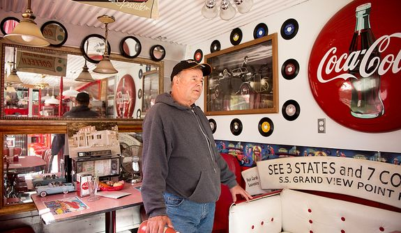 "Dennis Bowser of Alum Bank, Pa., stands inside his small diner replica which he has built on his property, Alum Bank, Pa., Monday, October 22, 2012. ""There's a lot of coal in this area, Says Bowser, ""When you shut coal down, you get rid of a lot of jobs. It's their livelihood."" (Andrew Harnik/The Washington Times)"