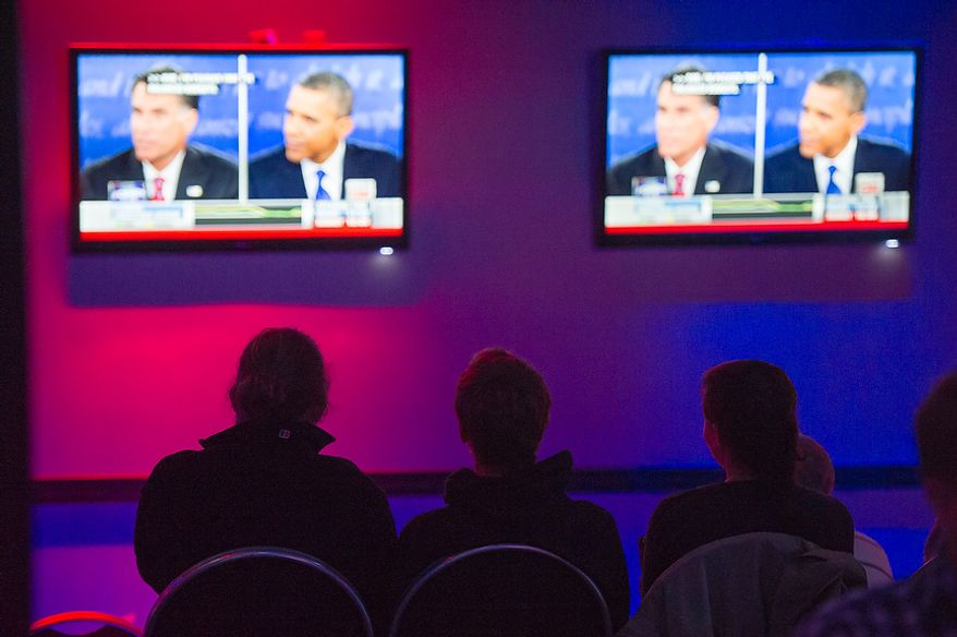 Obama supporters watch the third presidential debate at a debate viewing party at Cruze Bar in downtown Pittsburgh, Pa., Monday, October 22, 2012. (Andrew Harnik/The Washington Times)