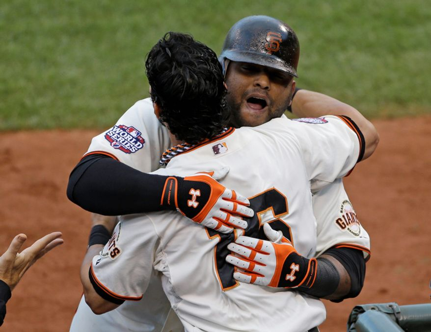 San Francisco Giants 3B Pablo Sandoval is congratulated by teammate Angel Pagan after hitting a home run in the first inning of Game 1 of the World Series between the Giants and Detroit Tigers in San Francisco on Oct. 24, 2012. (Associated Press)