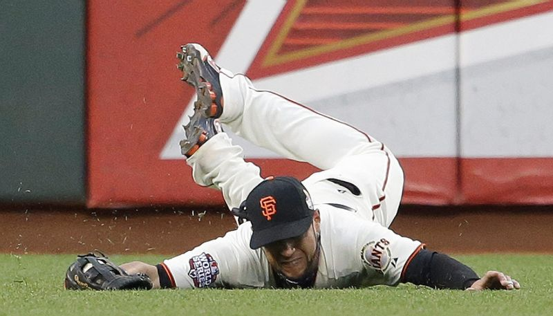 San Francisco Giants LF Gregor Blanco dives as he catches a ball hit by Detroit Tigers 3B Miguel Cabrera during the third inning of Game 1 of the World Series in San Francisco on Oct. 24, 2012. (Associated Press)