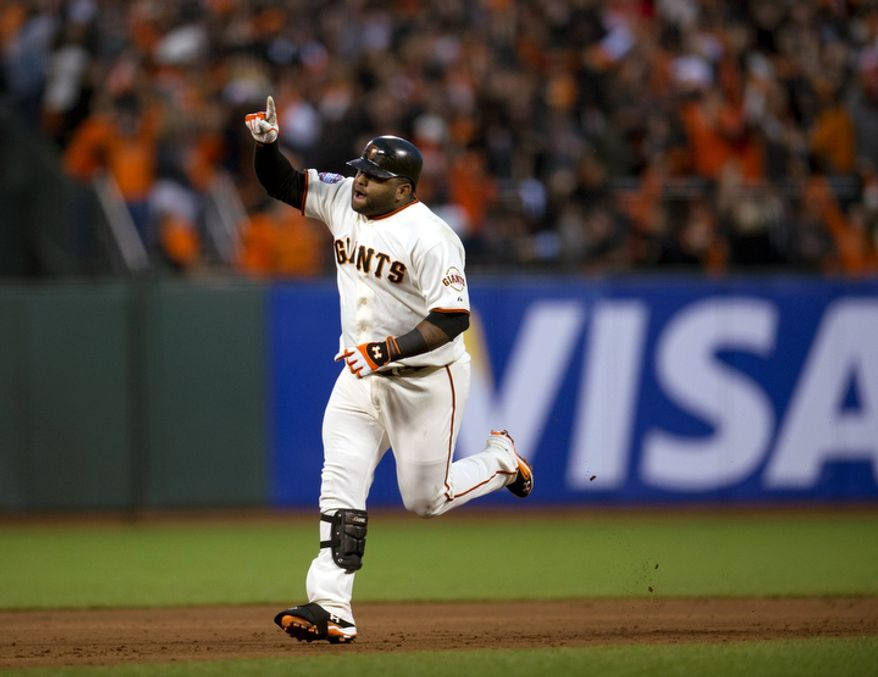 San Francisco Giants 3B Pablo Sandoval rounds the bases after hitting his second home run against the Detroit Tigers during Game 1 of the World Series in San Francisco on Oct. 24, 2012. (Associated Press/The Sacramento Bee)