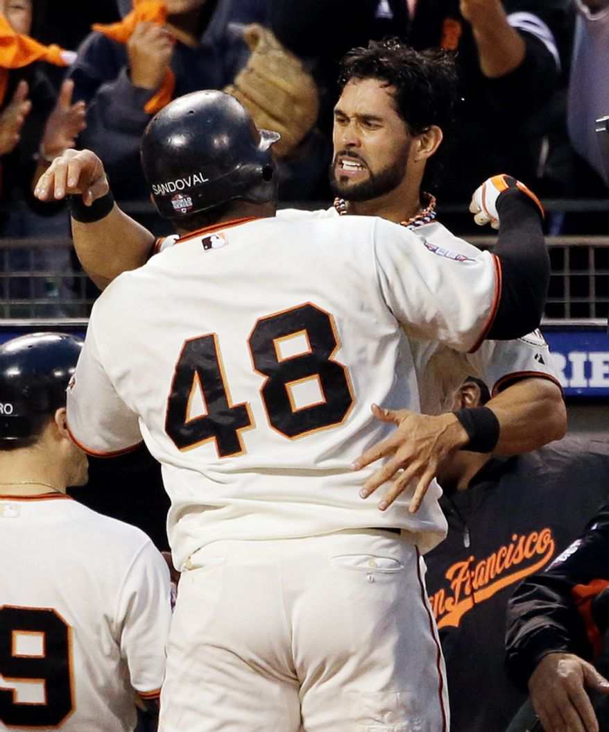 San Francisco Giants 3B Pablo Sandoval is congratulated by teammate Angel Pagan after hitting a two-run home run in the third inning of Game 1 of the World Series between the Giants and Detroit Tigers in San Francisco on Oct. 24, 2012. (Associated Press)